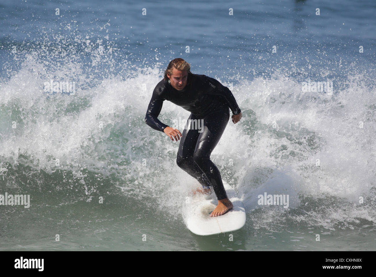 EL PORTO, MANHATTAN BEACH, CALIFORNIA, USA - OCTOBER 1. Surfers enjoy large waves on October 1, 2012. - Stock Image