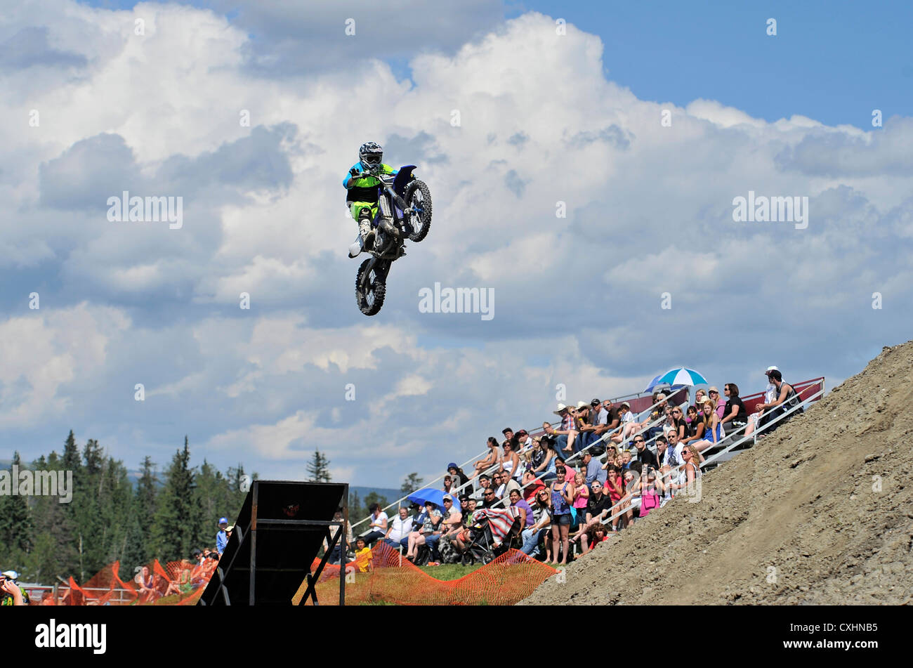A motocross rider preforming an aerial stunt - Stock Image
