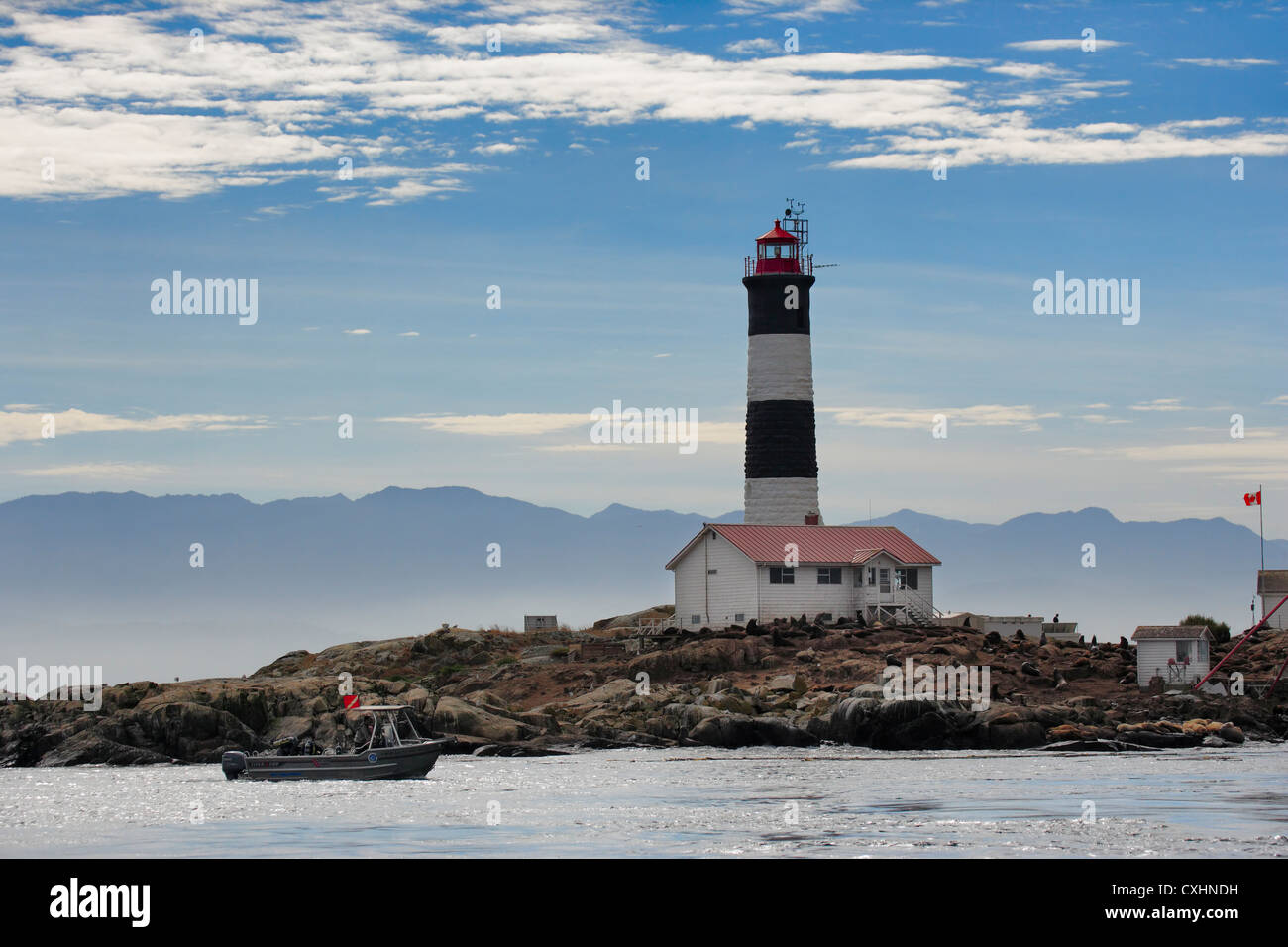 Race Rocks Lighthouse and Ecological reserve with scuba divers in boat-Victoria, Vancouver Island, British Columbia, - Stock Image