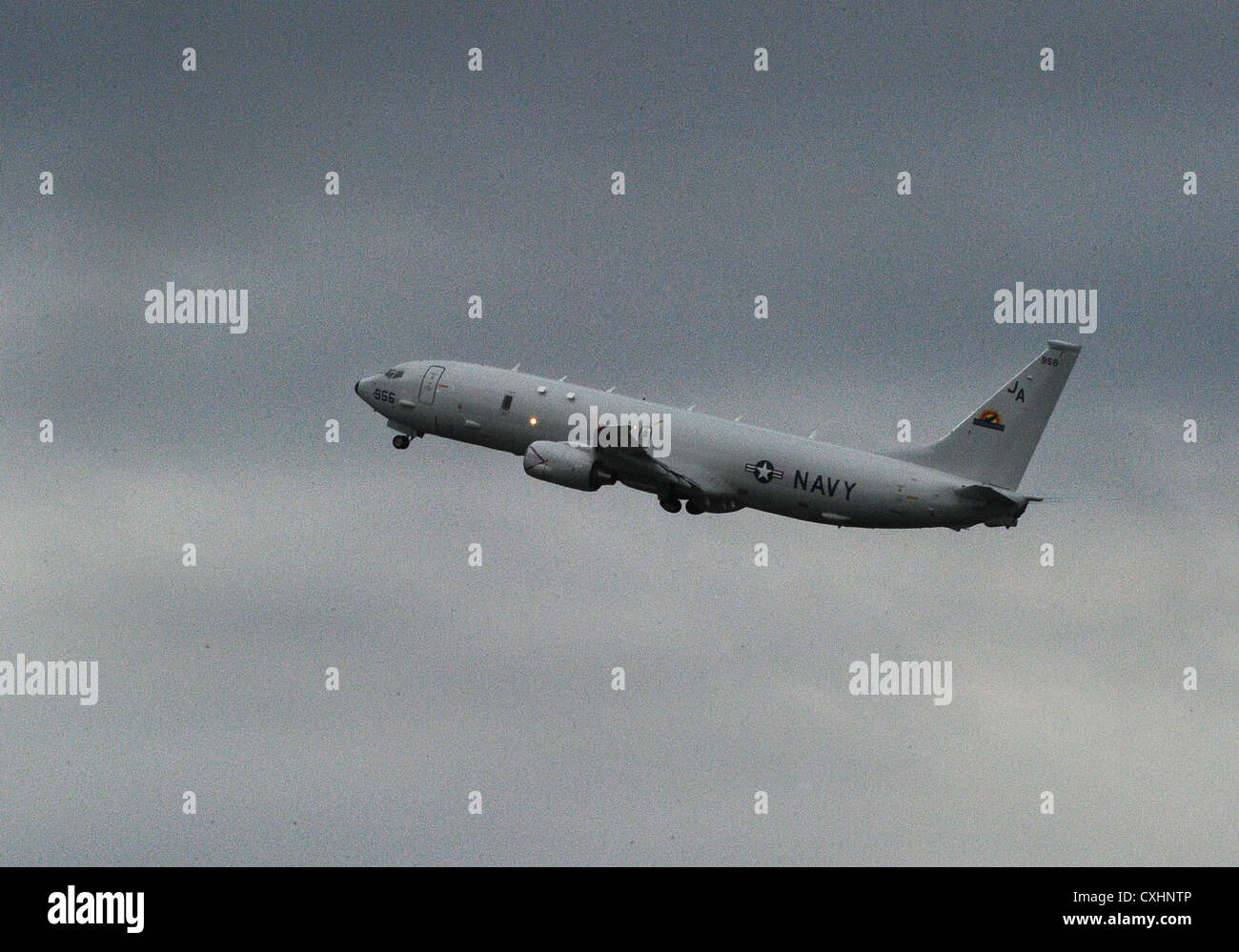 A P-8A Poseidon takes off from the flight line at Naval Air Facility Atsugi. The P-8A Poseidon is the Navy's - Stock Image