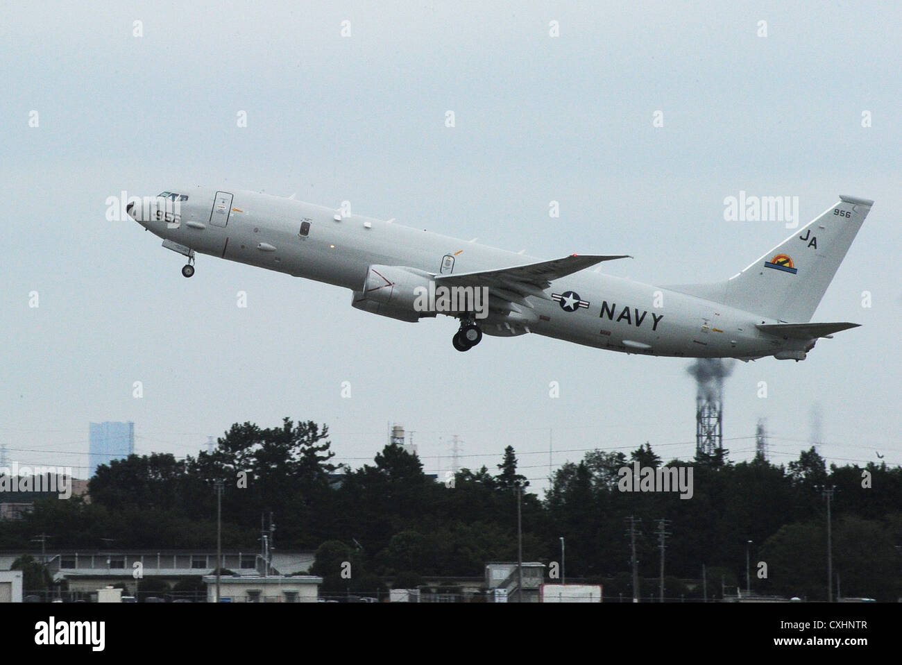 P-8A Poseidon takes off from the flight line at Naval Air Facility Atsugi. The P-8A Poseidon is the Navy's replacement - Stock Image