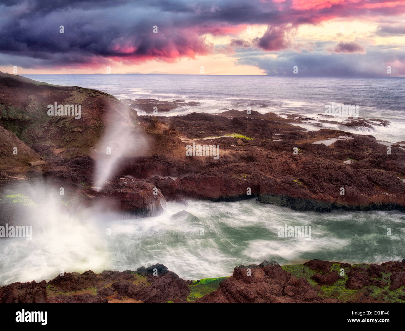 Cook's Chasam with breaking waves and sunset. Oregon - Stock Image