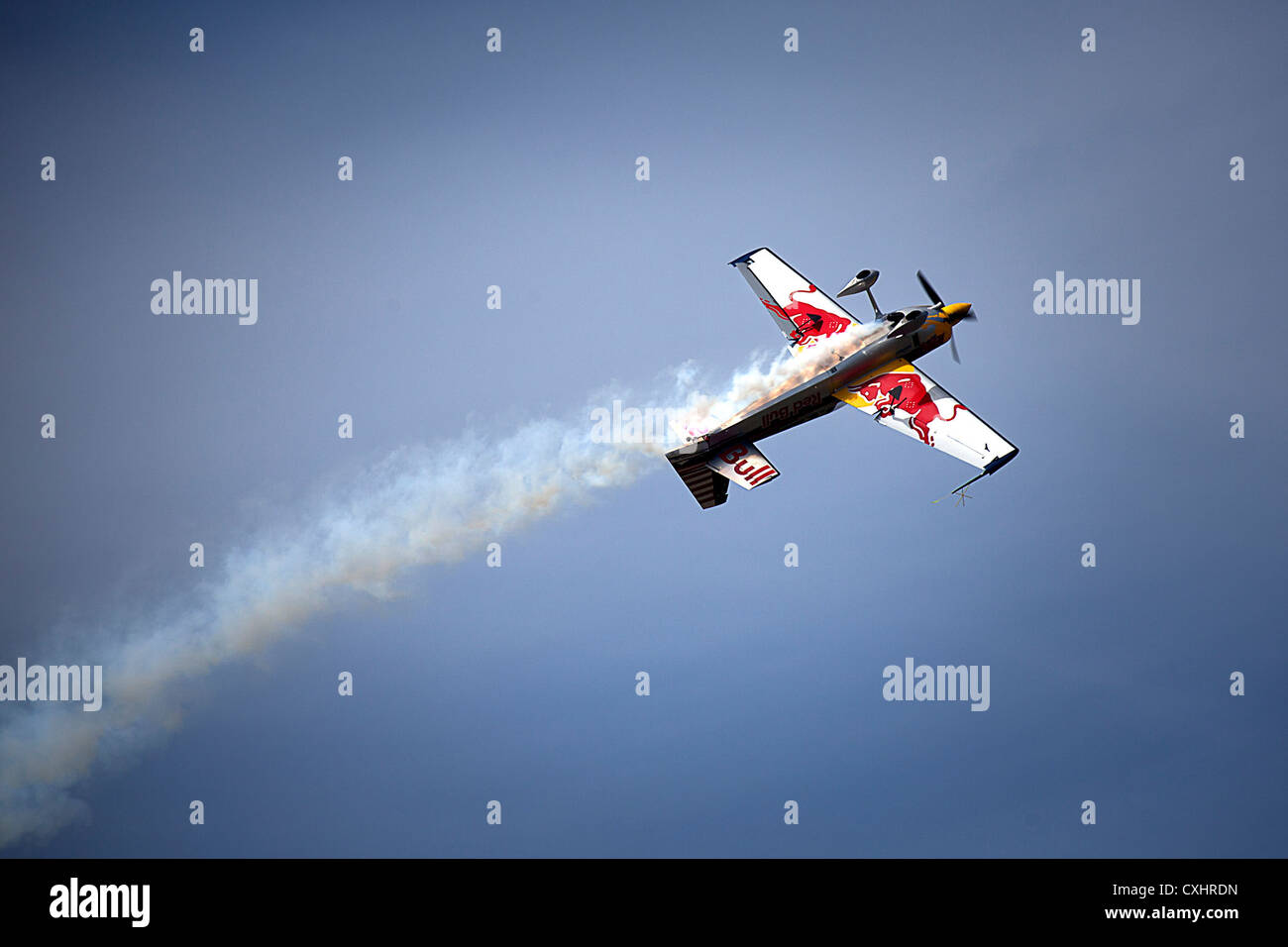 Aerobatic performer Kirby Chambliss flies his Red Bull Edge 540 aircraft upside down while performing during the - Stock Image