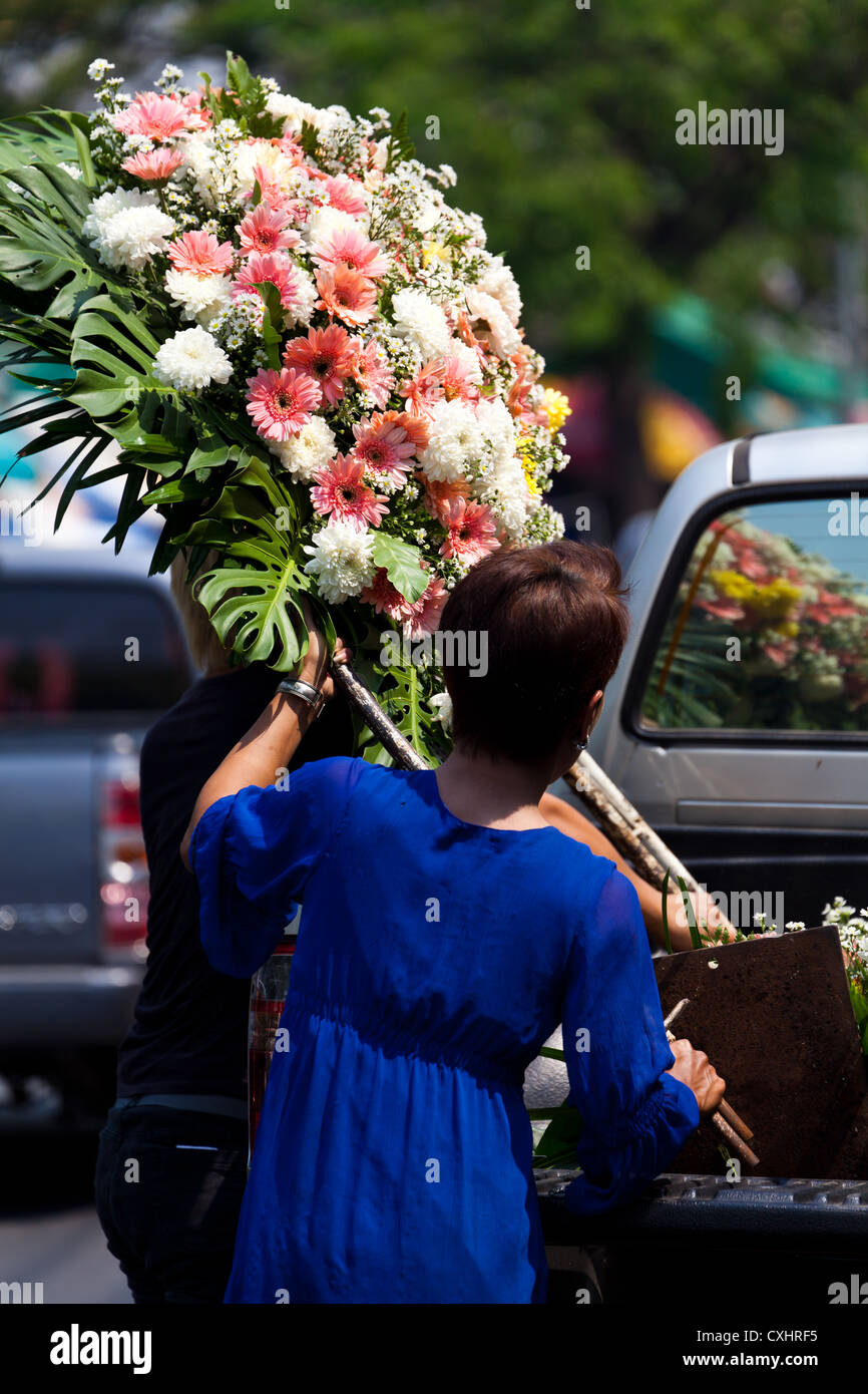 Unloading Flowers on a Flower Market in Chiang Mai in Thailand - Stock Image