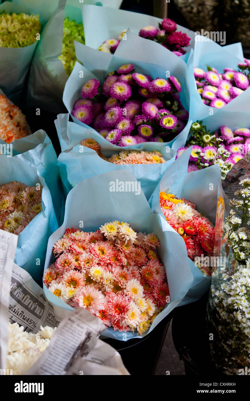 Sale of Flowers on a Flower Market in Chiang Mai in Thailand - Stock Image
