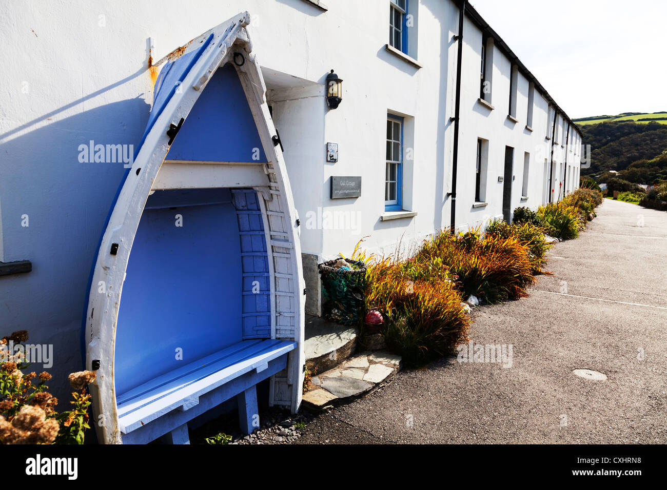 Interesting boat shaped seat bench outside home in Boscastle, Cornwall - Stock Image