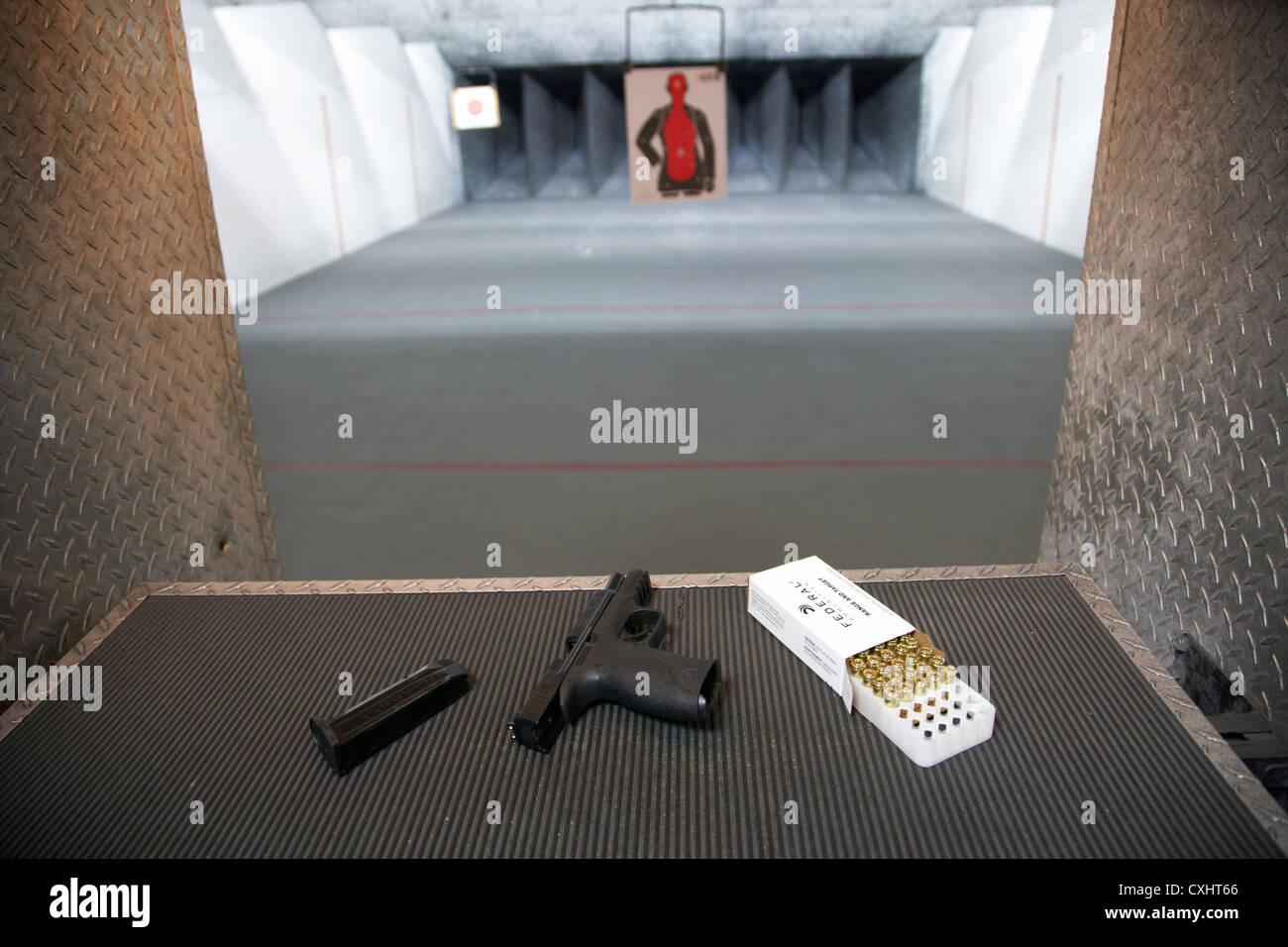 smith and wesson 9mm handgun with ammunition at a gun range in florida usa - Stock Image