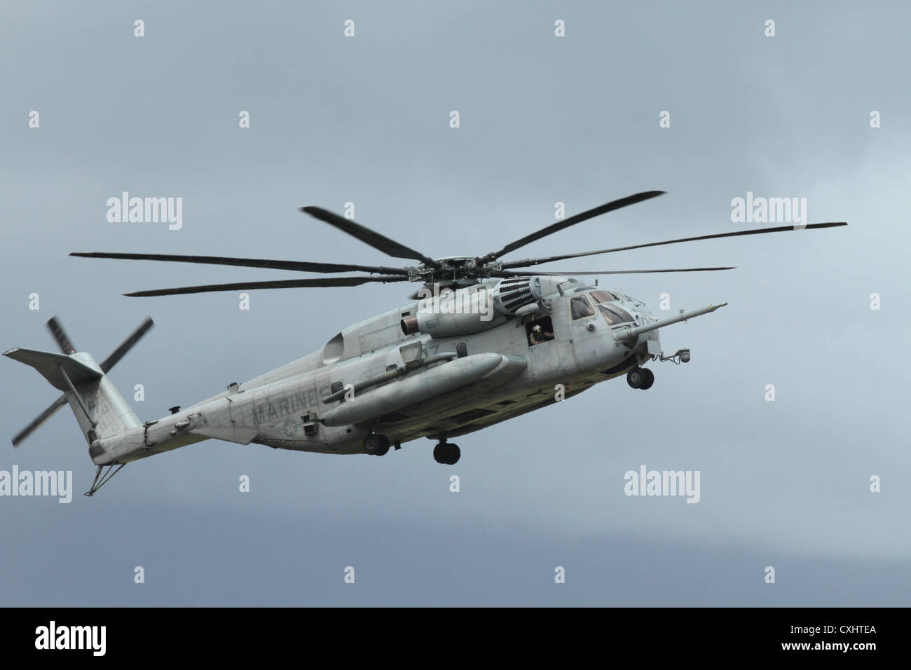 A CH-53E Super Stallion helicopter demonstrates its landing capabilitiy during the 2012 Kaneohe Bay Air Show on - Stock Image