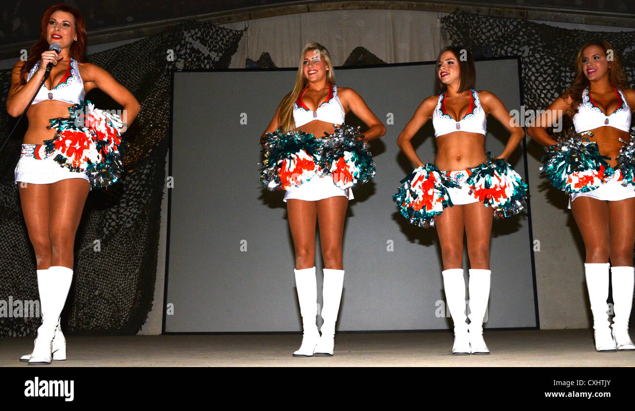 Miami Dolphins cheerleaders Amy Madill, Samantha Ruiz, Lily Watters and Natalie Diaz perform for the troops at Bagram - Stock Image