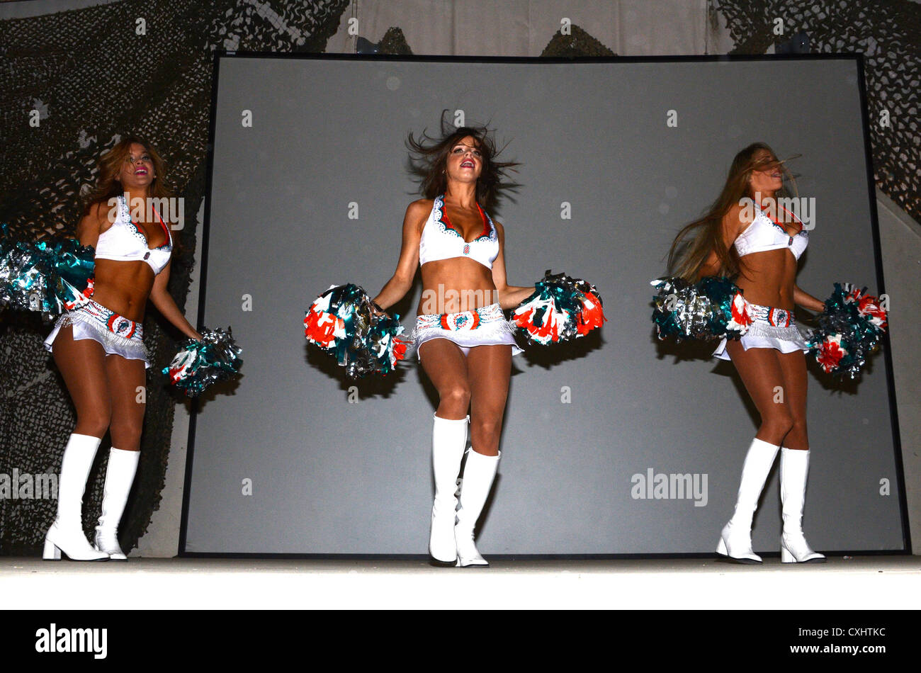 Miami Dolphins cheerleaders Natalie Diaz, Samantha Ruiz and Lily Watters perform for the troops at Bagram Aifield, - Stock Image