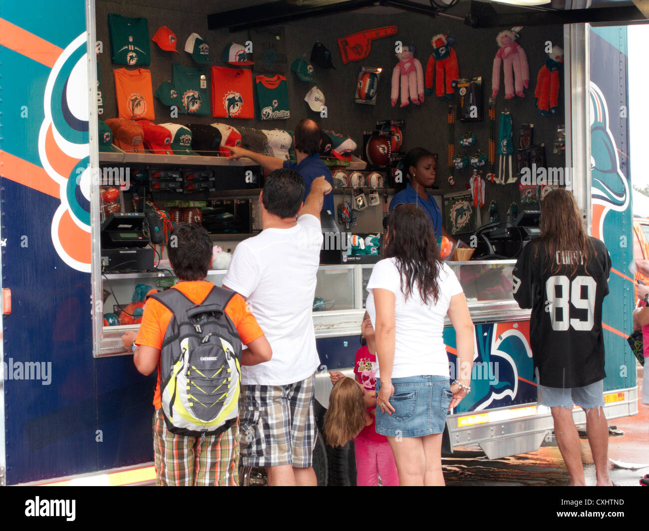 4bc14d40 miami dolphins fans at a merchandise store trailer at sun life Stock ...