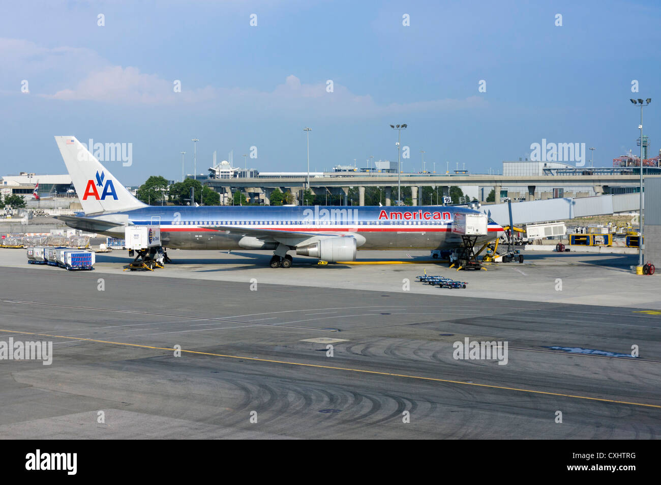 An American Airlines Boeing 767-323 aircraft parked at the gate at JFK Airport, New York, USA - Stock Image