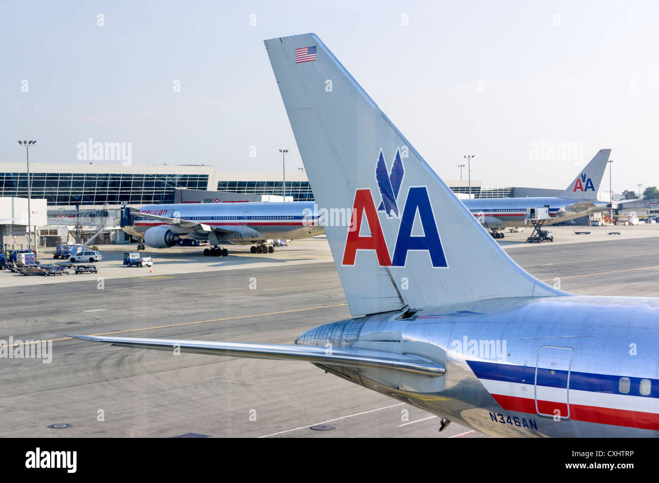 An American Airlines Boeing 767-300 aircraft parked at the gate at JFK Airport, New York, USA - Stock Image