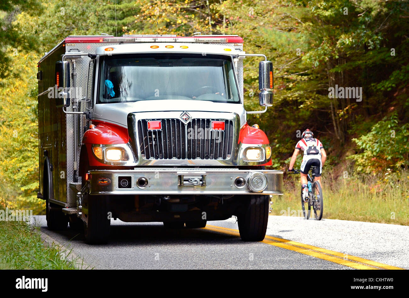 An EMT emergency firetruck on the way to help after getting a distress call. - Stock Image