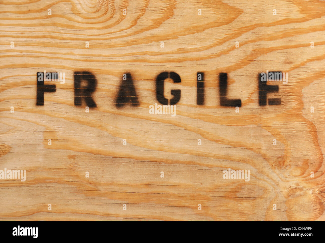 fragile stenciled on shipping packing crate - Stock Image