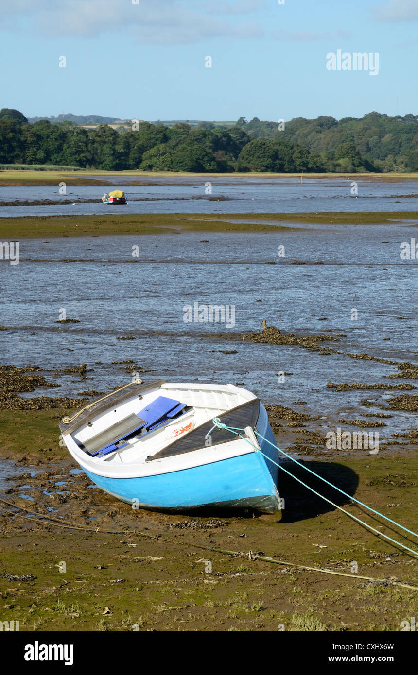 A dinghy at low tide on the carnon river near devoran in cornwall, uk - Stock Image