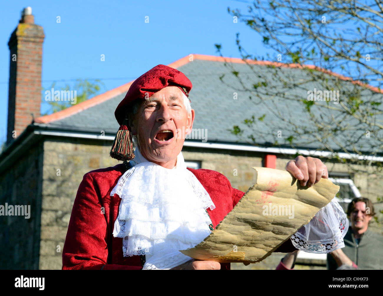 The narrator at the ' Hal-an-Tow ' pageant the early morning dance at the Helston Flora day celebrations - Stock Image