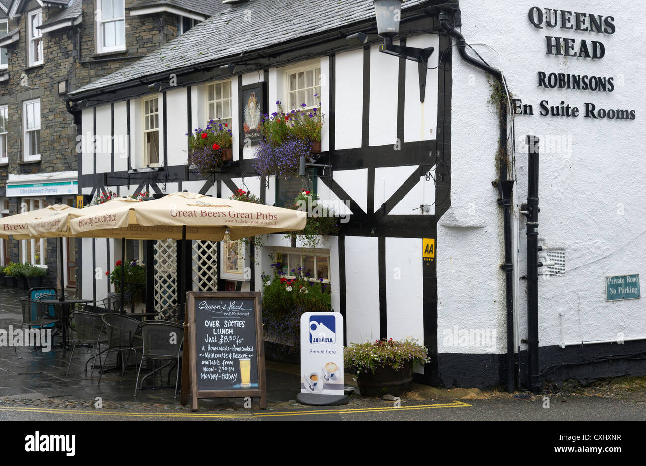 Queen's Head pub restaurant and hotel Hawkshead town Lake District Cumbria North West England UK - Stock Image