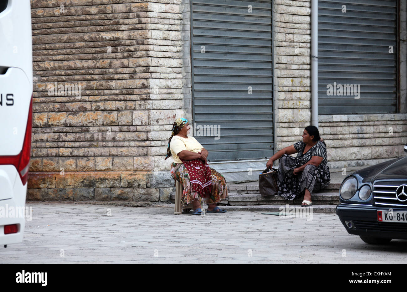 Albanian Roma Women Sat Chatting in the Street - Stock Image