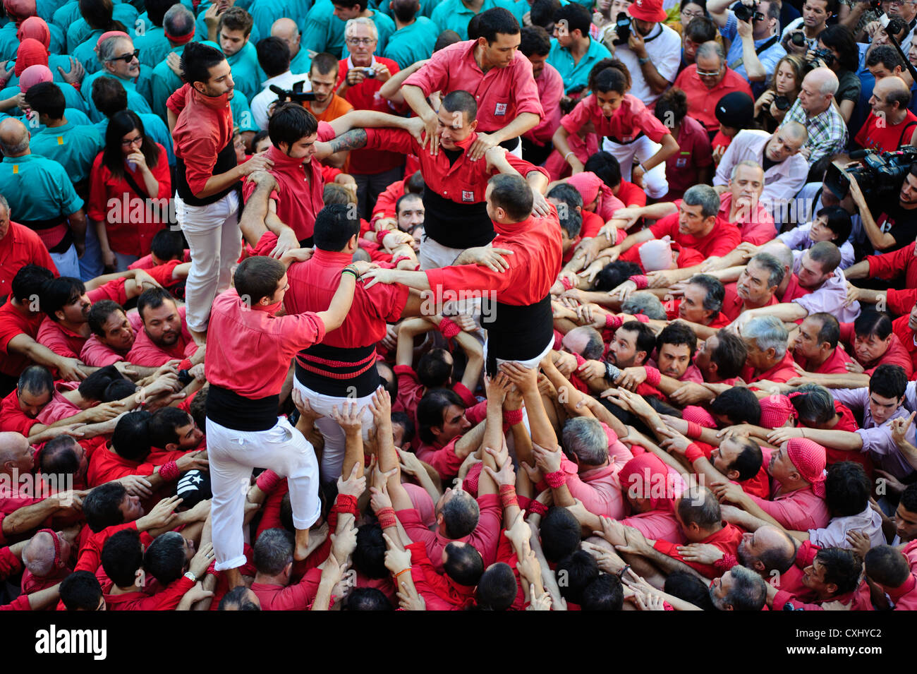 Traditional Castellers building human castles for La merce Festival in Barcelona, Spain. - Stock Image