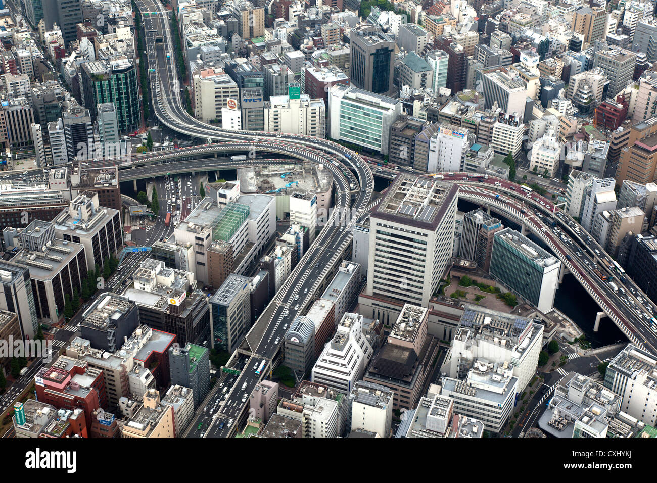Aerial shot of crowded road network snaking through central Tokyo, Japan - Stock Image