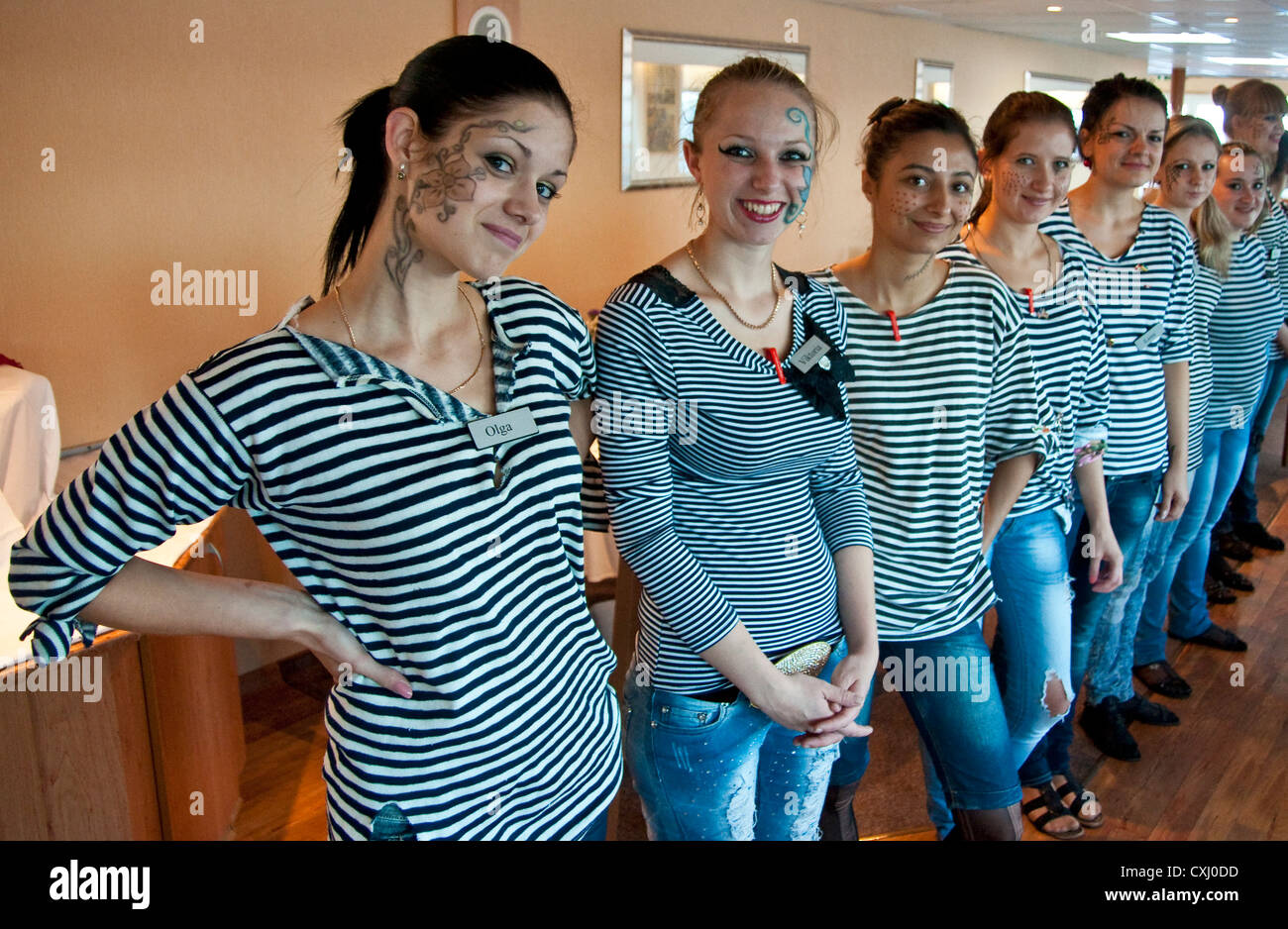 Kiev dining room wait staff fo Pirate Night theme on the Viking Lomonosov cruise ship on Dnieper River/Black Sea - Stock Image
