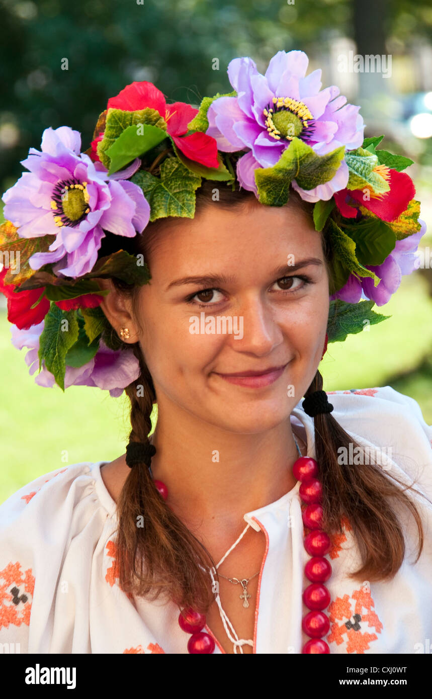 Young unmarried woman in traditional Ukrainian clothing in Kherson, Ukraine - Stock Image