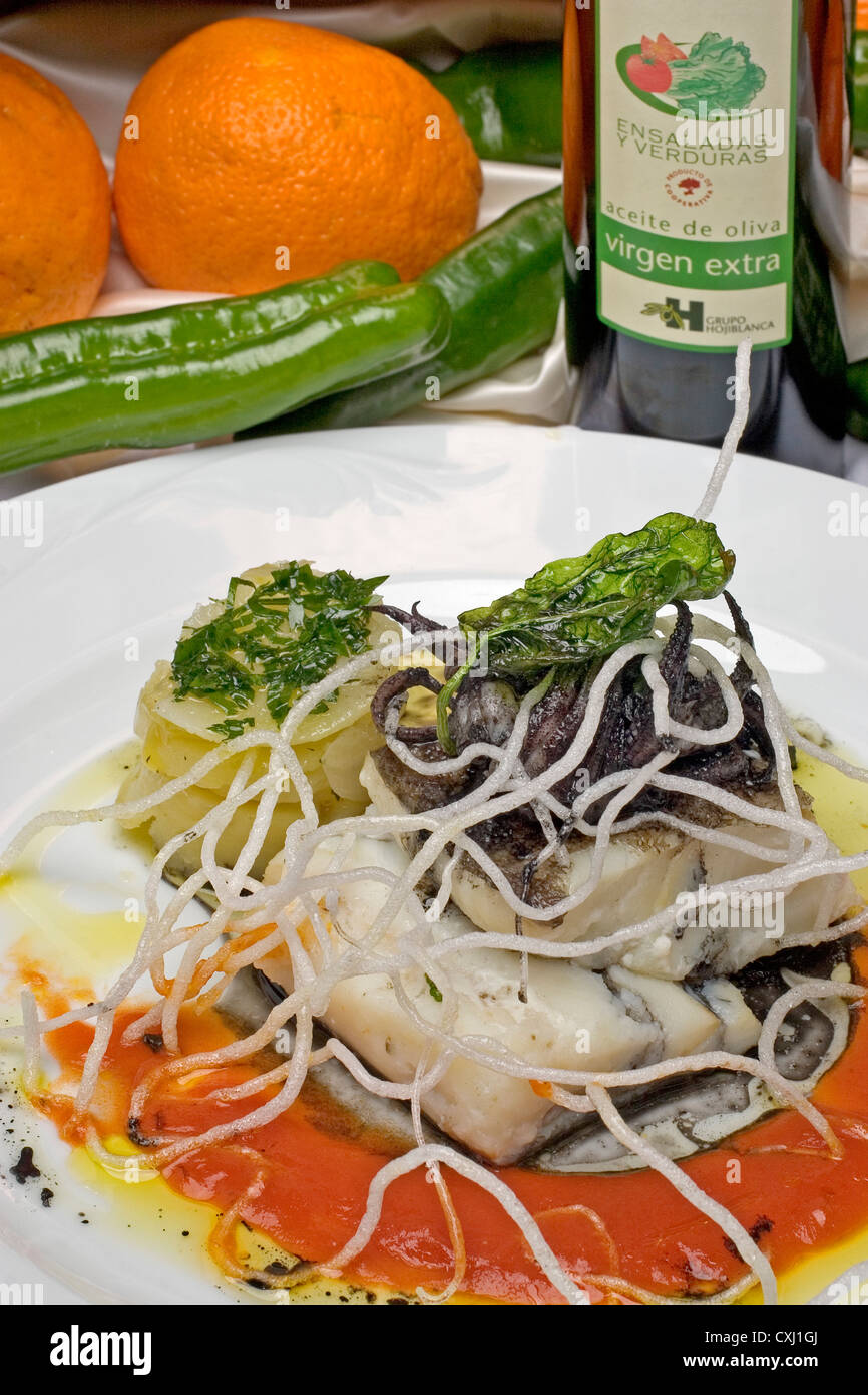 Chipiron cod in ink bacalao con chipiron en su tinta - Stock Image