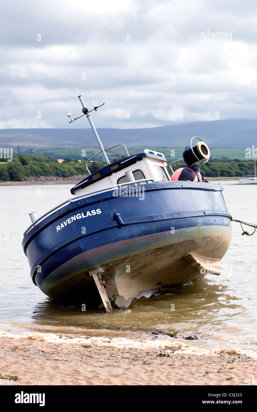Ravenglass boat anchored at Ravenglass, Cumbria. - Stock Image