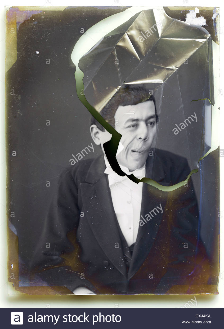 glass plate with broken emulsion of mime comedian portrait - Stock Image