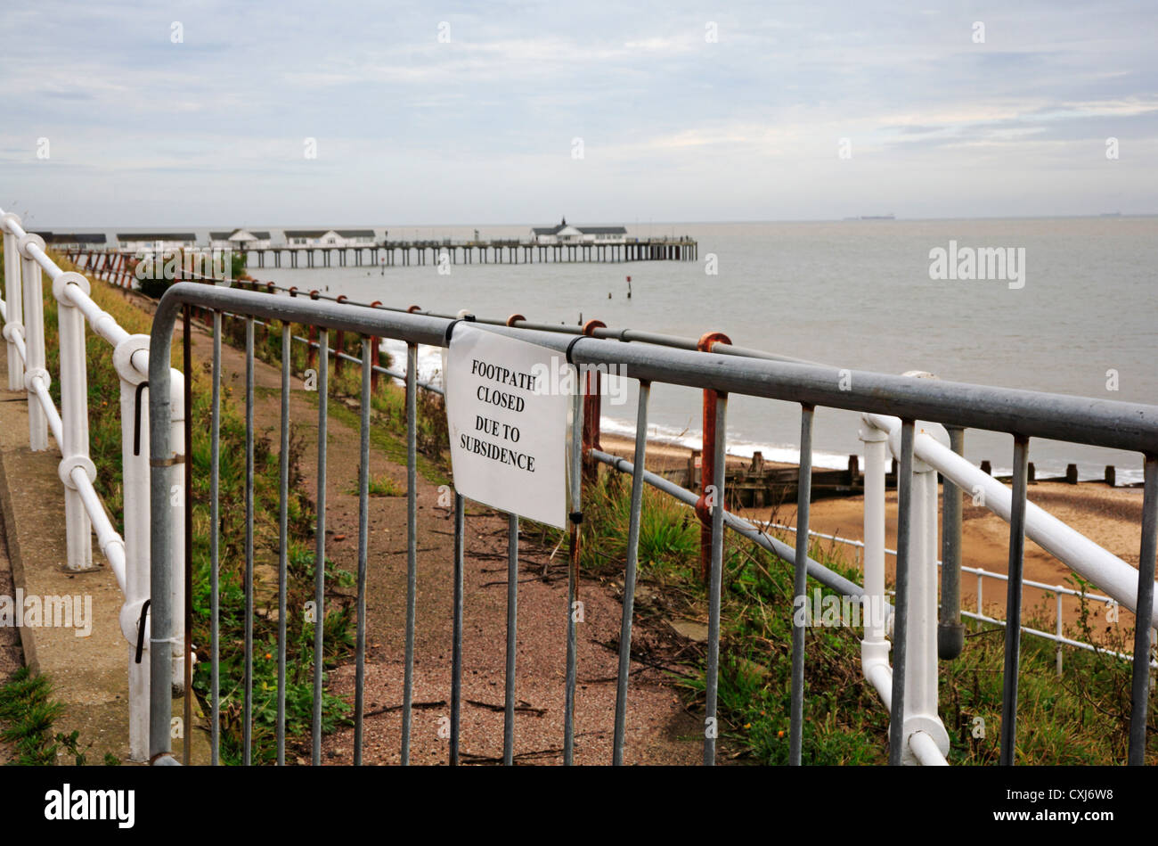 Barrier and notice closing a path to the beach due to subsidence at Southwold, Suffolk, England, United Kingdom. - Stock Image