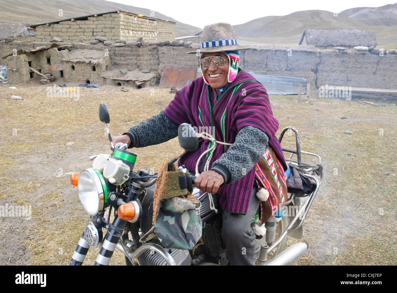 Aymara biker in the Cordillera - Stock Image