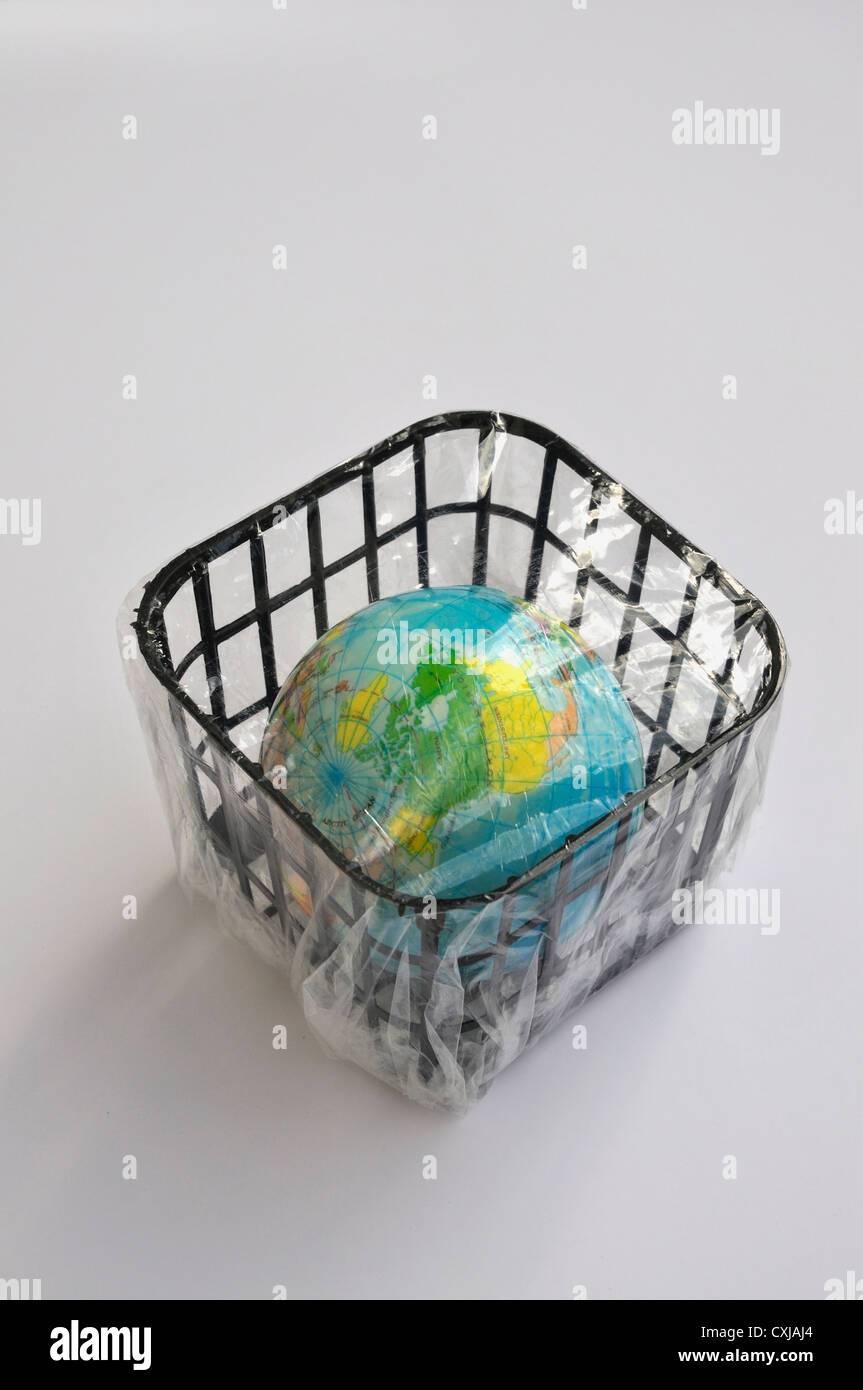 Small globe packed in basket - Stock Image