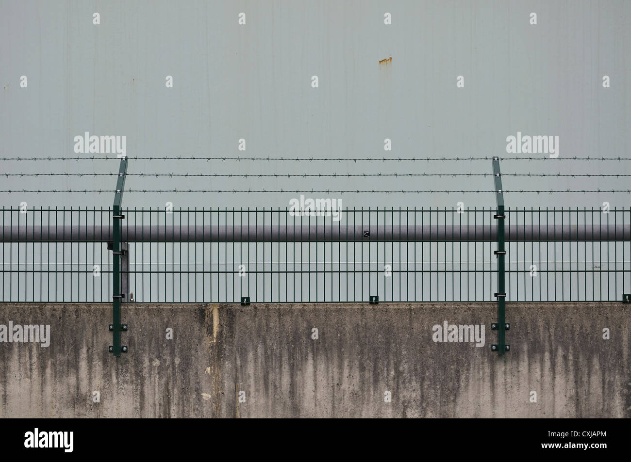 Germany, Bavaria, Wall with barb wire Stock Photo
