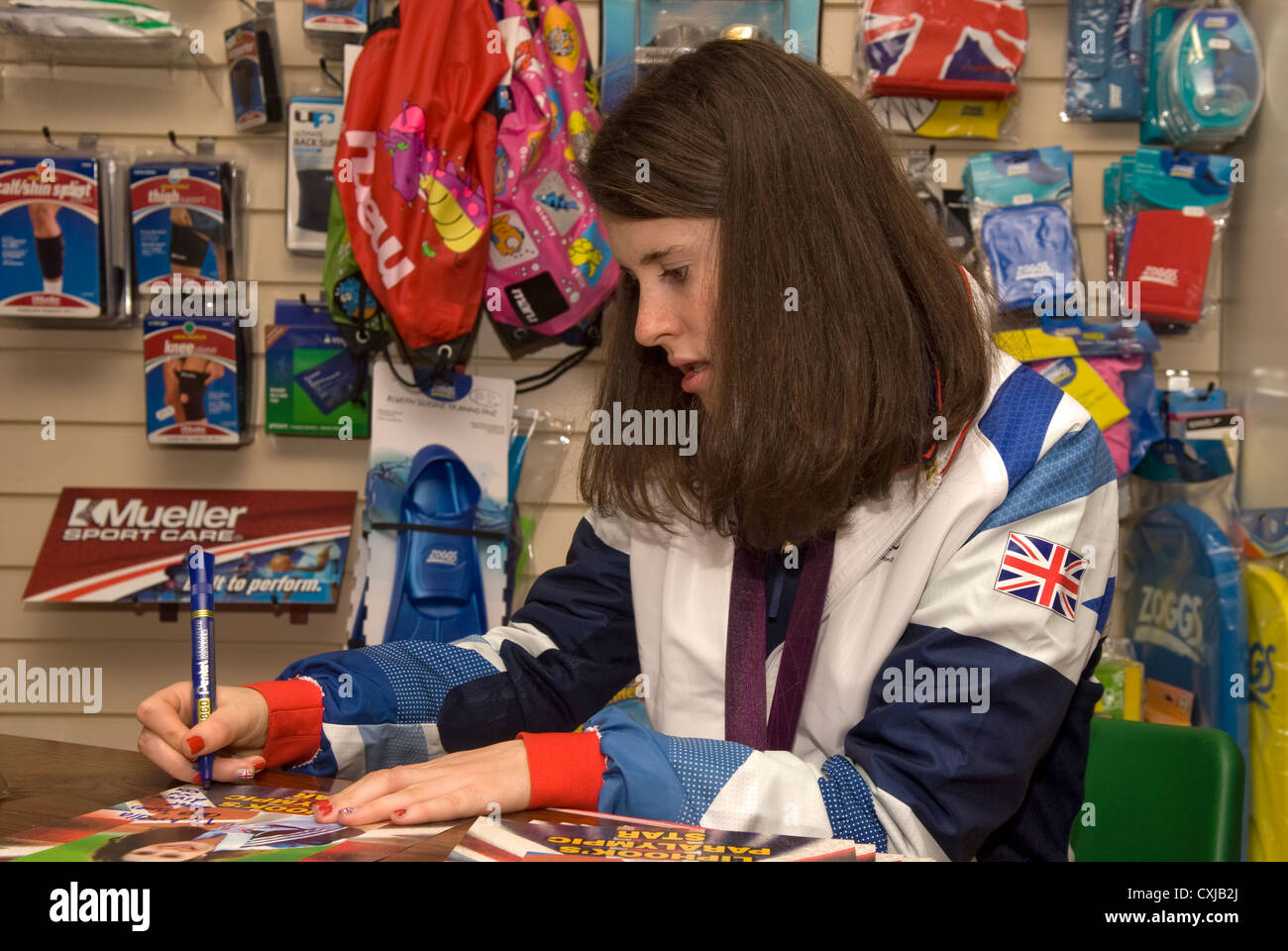 Olivia Breen, Bronze Paralympic medal winner at London 2012 Olympic games signing autographs, Liphook, Hampshire, - Stock Image