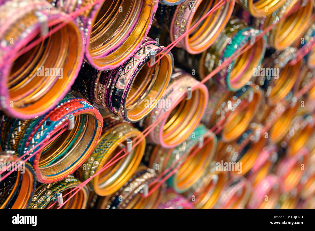 Indian bangles in a jewelry shop - Singapore - Stock Image