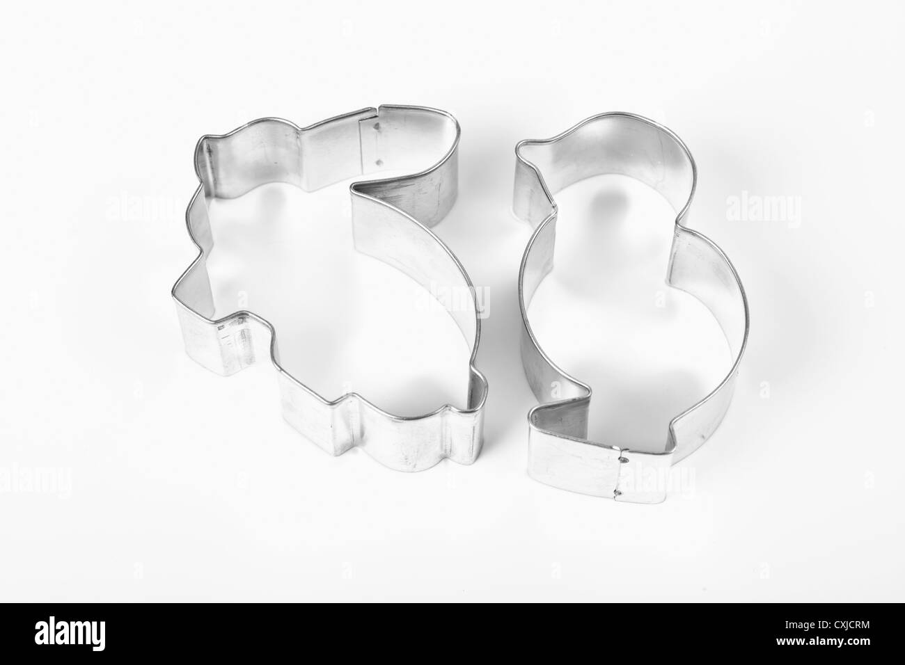 Cookie cutters in the traditional shape of a rabbit and a chick, used to make homemade cookies for the Easter holiday - Stock Image