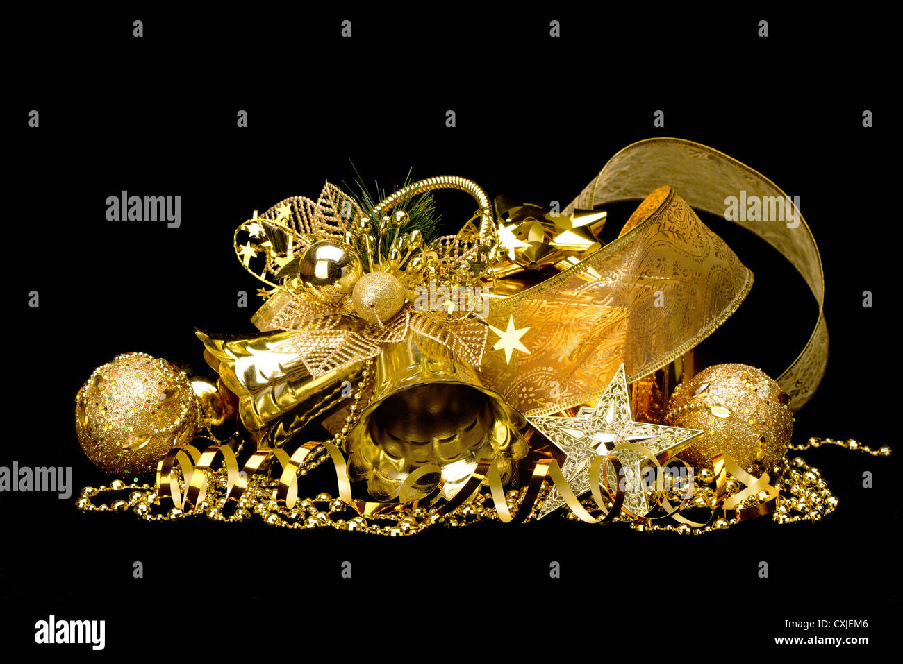 gold christmas decorations boxes ribbons stars bells on black background
