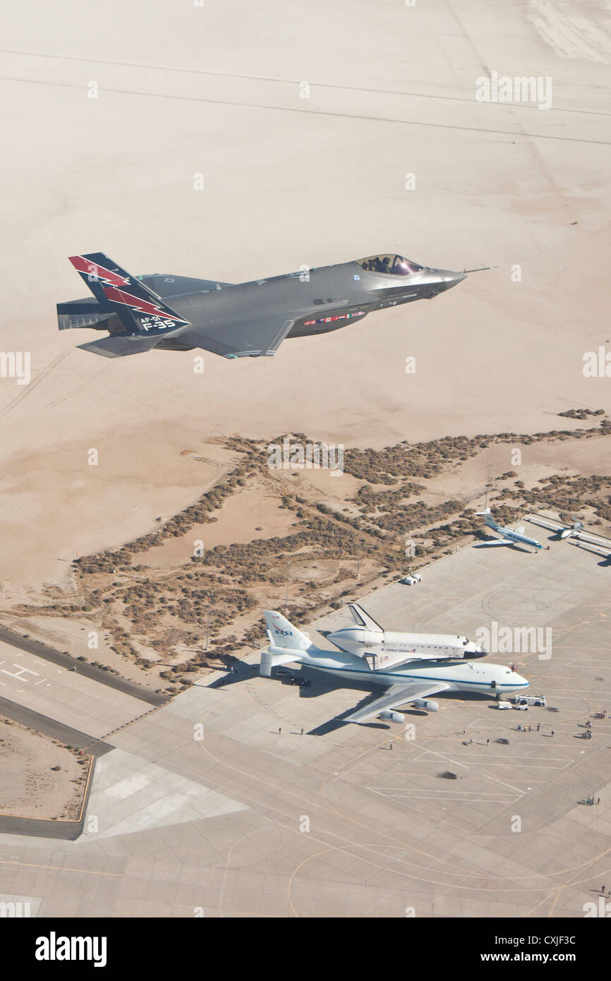 US Air Force F-35 Lightning II stealth fighter aircraft flies over the Space Shuttle Endeavour at Edwards Air Force - Stock Image