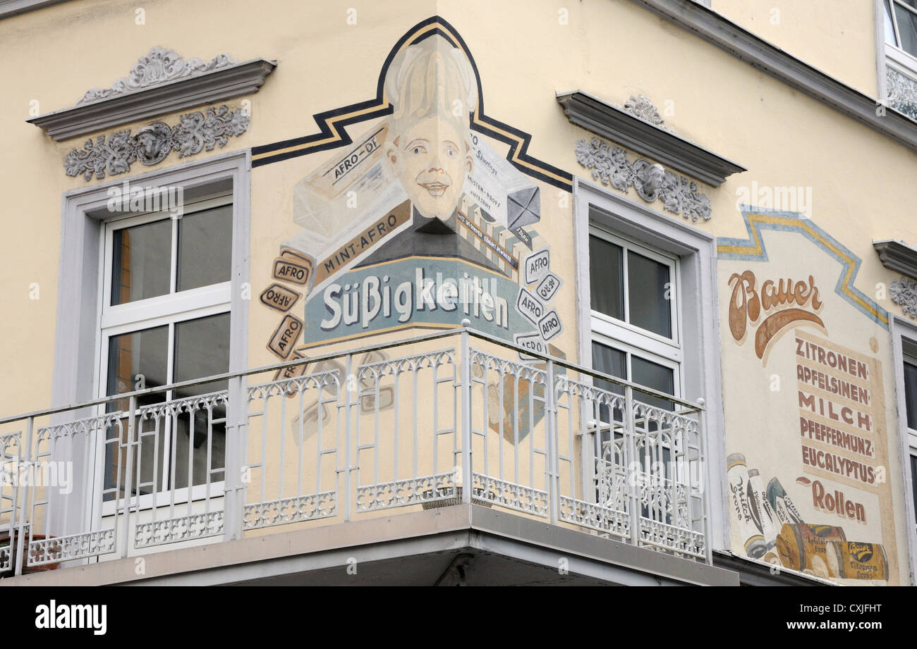 Old advert painted on the exterior of a building in Florinsmarkt, Koblenz, Germany - Stock Image