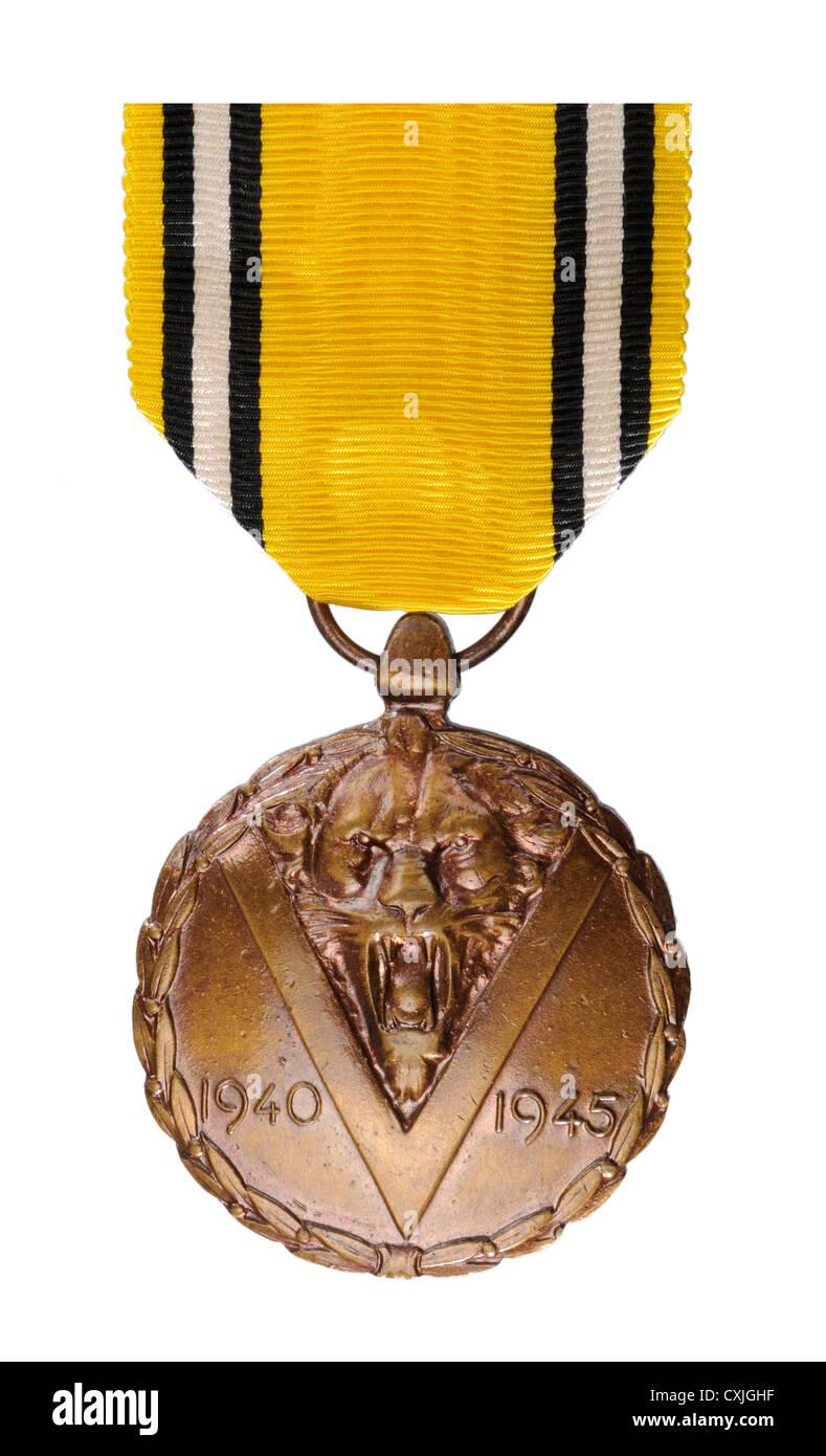 Belgian 1940-1945 WW2 commemorative medal. Medaille Commemorative de la Guerre / Herinneringsmedaille van den Oorlog - Stock Image