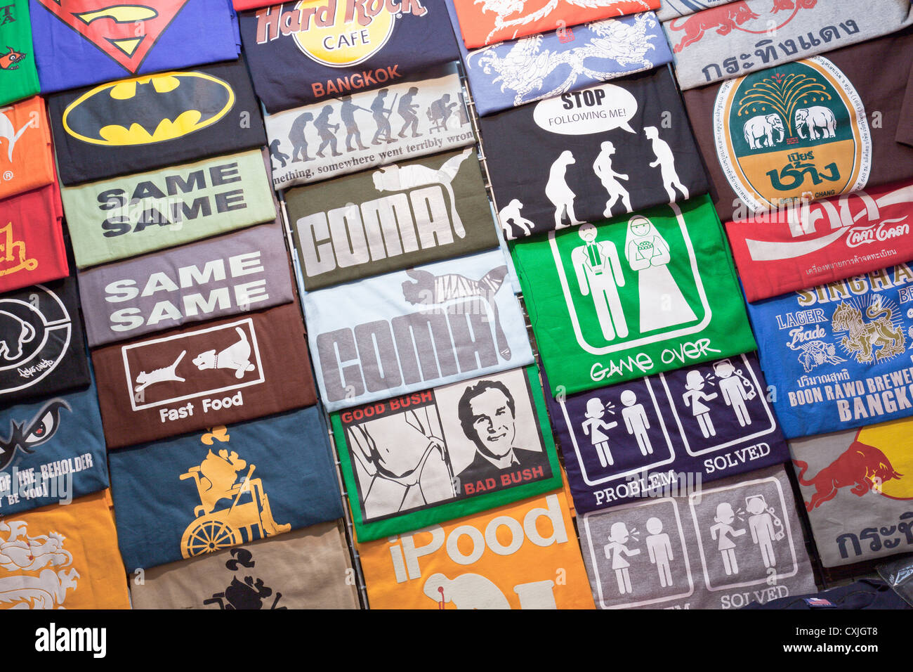Tee shirts on sale in the night market, Thanon Changklan, Chiang Mai, Thailand - Stock Image