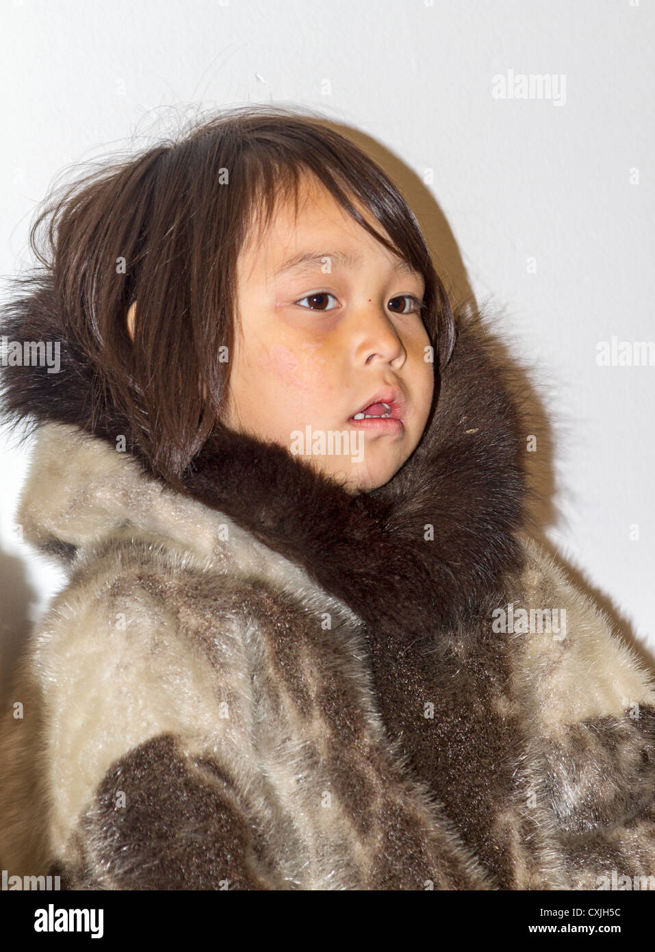 Young Inuit girl in traditional skin clothing. Grise Fjord, Nunavut, northernmost community in Canada - Stock Image