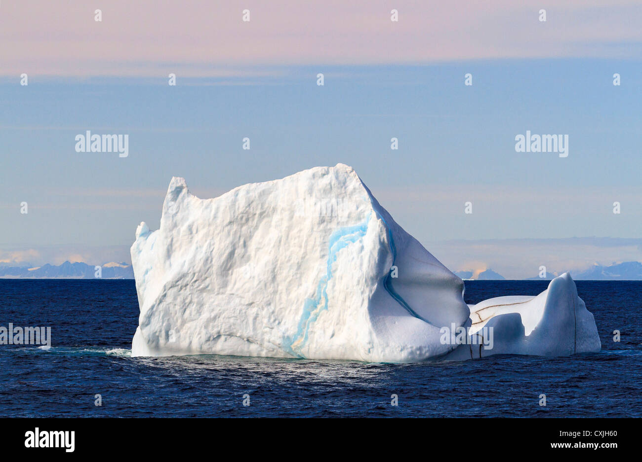 Iceberg floating in ocean water of Smith Sound in the high arctic of Nunavut, Canada, mid summer. - Stock Image
