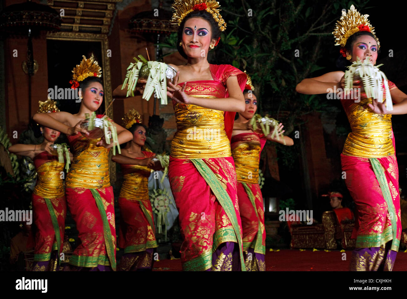 A barong dance performance at outdoor theatre at night in Ubud, Bali, Indonesia - Stock Image