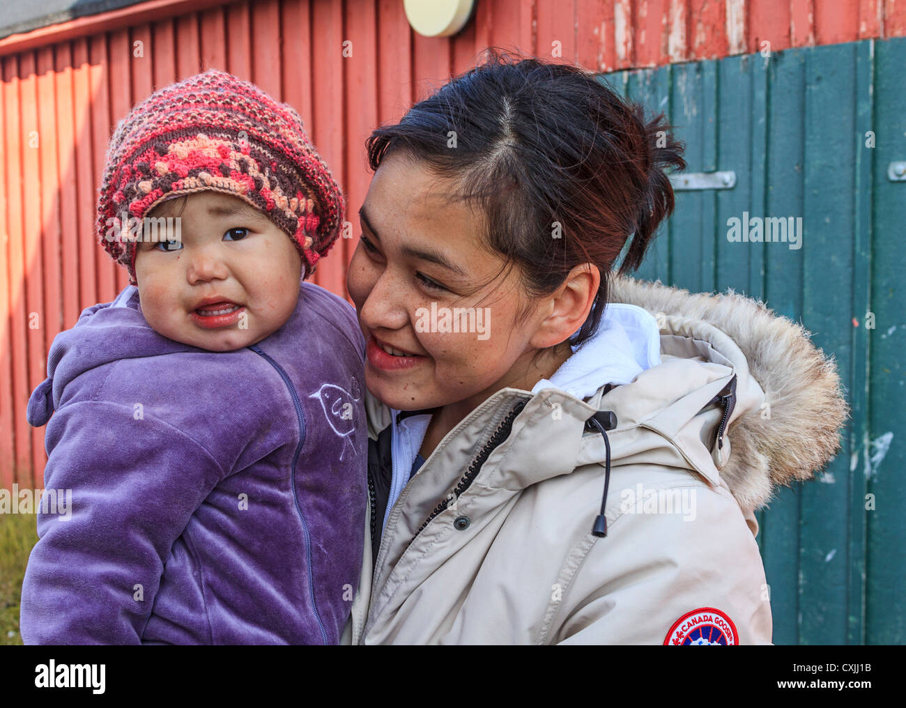 Young Inuit mother and her baby girl in Itilleq, a village of 80 Inuit people on the southwest coast of Greenland. - Stock Image