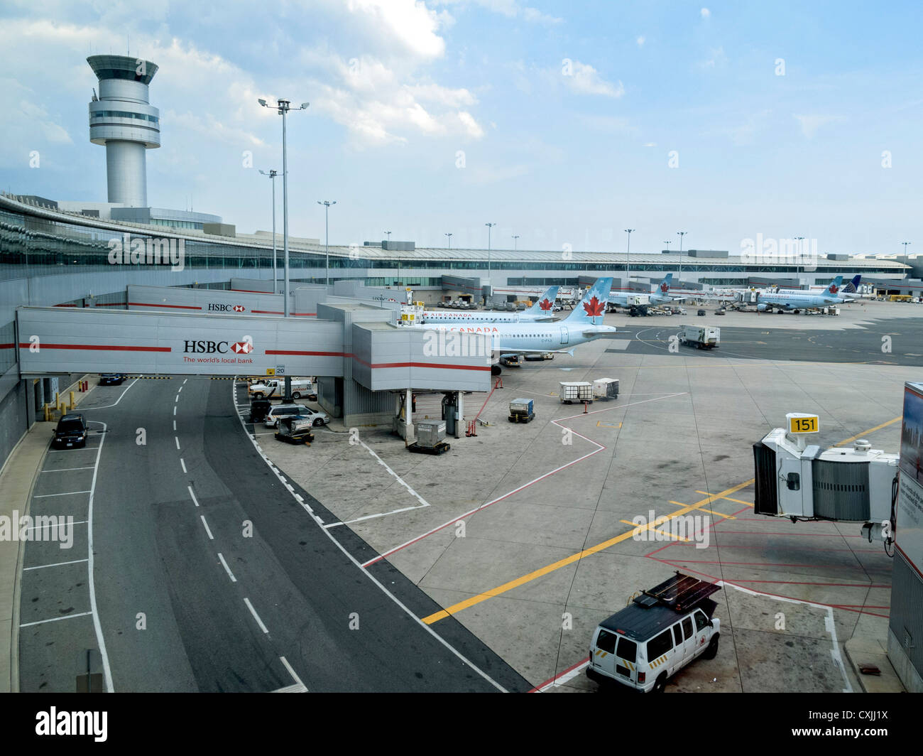 Tarmac with jets unloading and loading passengers, Pearson International Airport, Toronto, Canada. - Stock Image