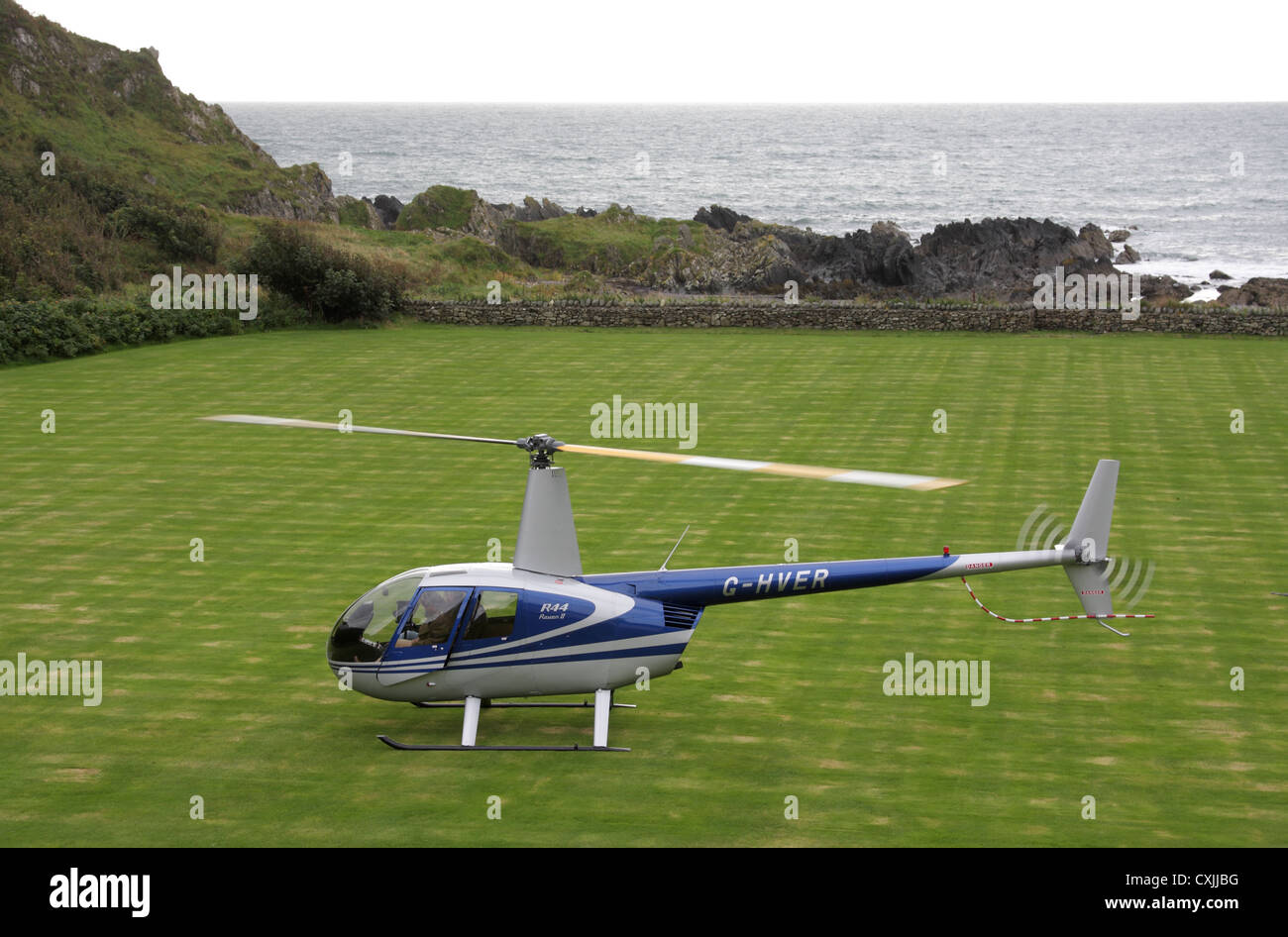 Guests arrive by private helicopter at Knockinaam lodge hotel, near Portpatrick, Dumfries and Galloway, Scotland, - Stock Image