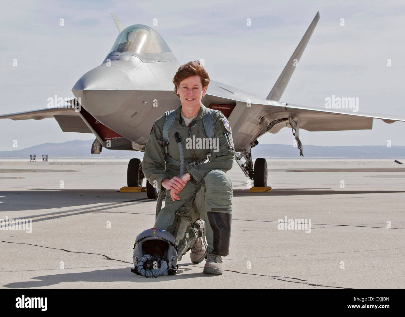 us air force pilot col dawn dunlop poses in front of her f 22 raptor stock photo 50811369 alamy. Black Bedroom Furniture Sets. Home Design Ideas