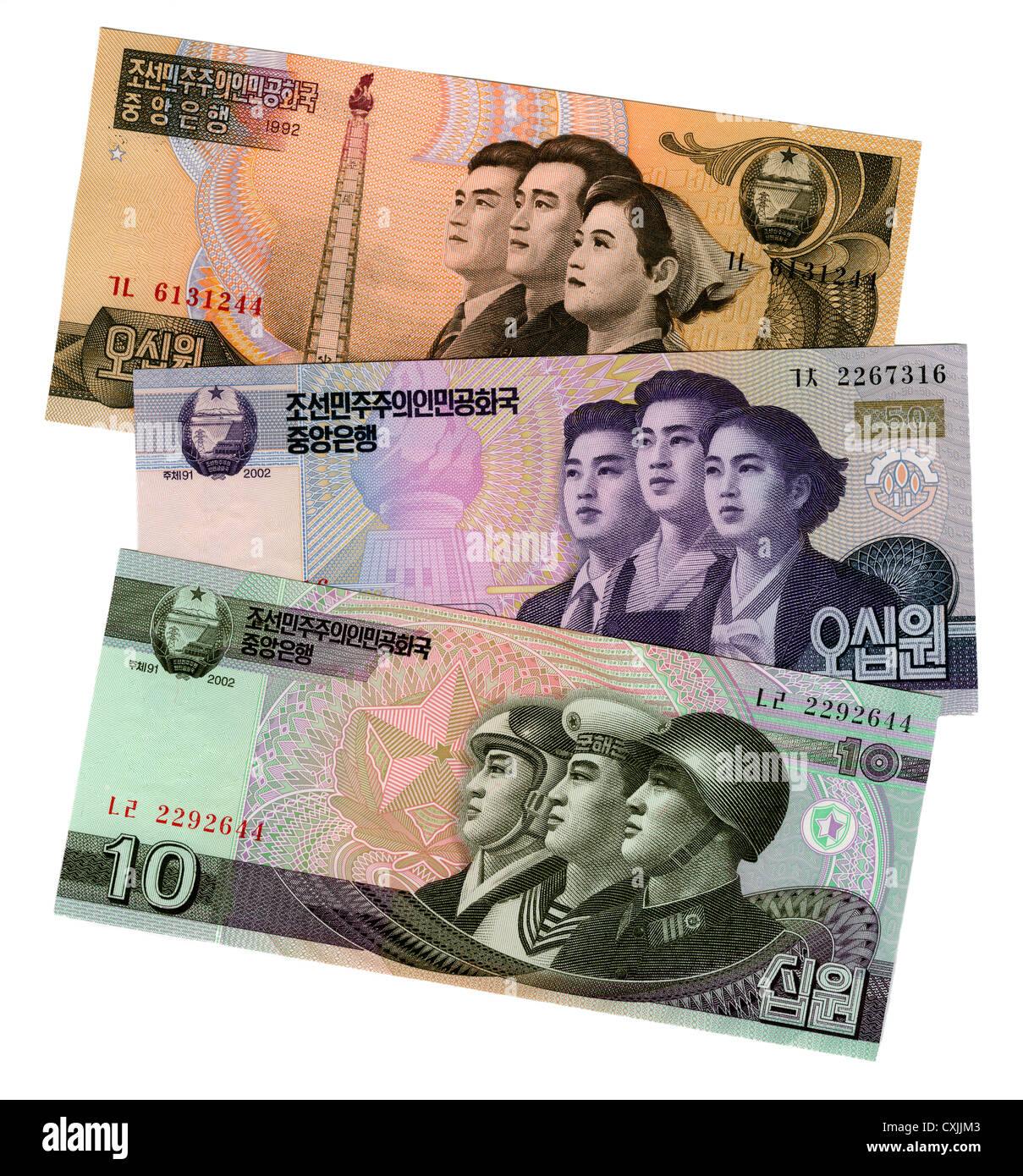 North Korean Banknotes showing Communist propaganda images of citizens, workers and armed forces. - Stock Image